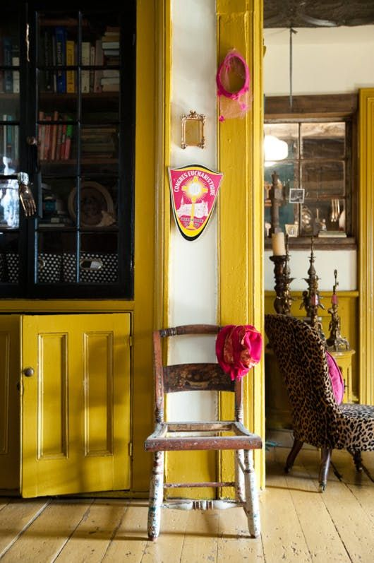 mustard yellow built in and molding in bohemian house