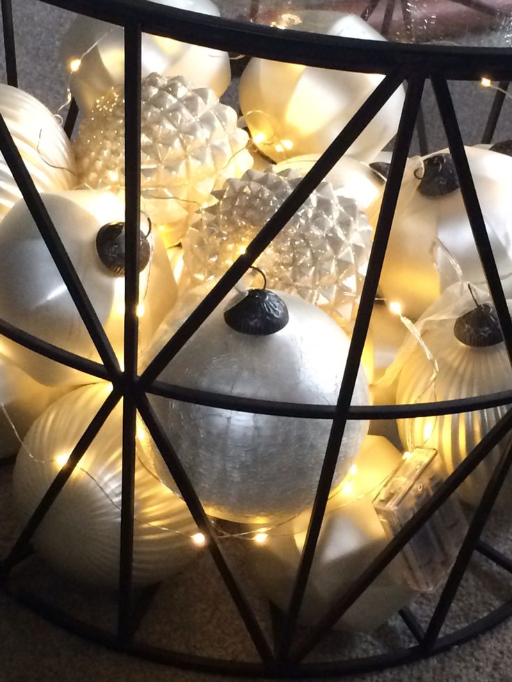 One of my first Christmas decorating must dos is to dig out my lovely large baubles and twinkly seed lights, pop them in the base of our coffee table and ta da instant Christmas sparkle