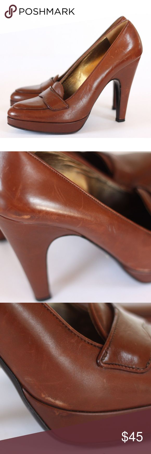 Prada Brown Leather High Heeled Loafters Pair of high heel loafers from pradawith  brown leather with an almond toe. They are structurally in good condition HOWEVER the leather does have scratches and scuffs. There are products that can repair this or it can be taken to a cobbler. Please note the pictures. We can send additional pictures and measurements upon request. The shoes are a size european 39. IMO they RUN SMALL. I wear a 9 and these are more of an 8. They are also on the narrower…