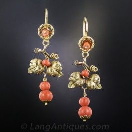 Dating back from late nineteenth century, darling Victorian coral ear dangles, measuring 1 3/4 inches (they drop a bit lower) hand-fabricated in 14 karat gold with a charming foliate design.
