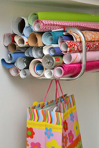 bike rack to organize wrapping paper- clever!