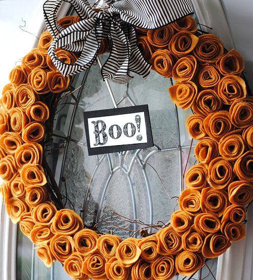 Great felt wreath on grape vine. Would look nice in white with at white bow for Christmas too.