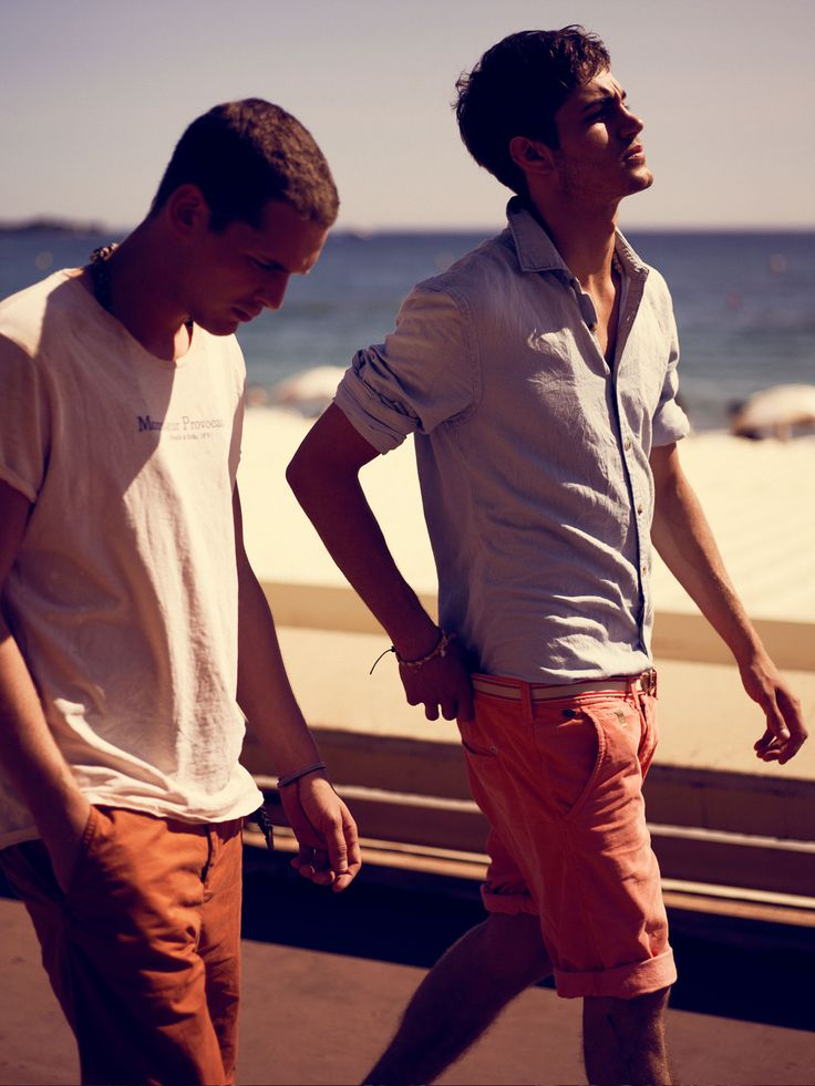 I like the look of the blue shirt one, but I think coral pants are too metrosexual. Normal color shorts, please.