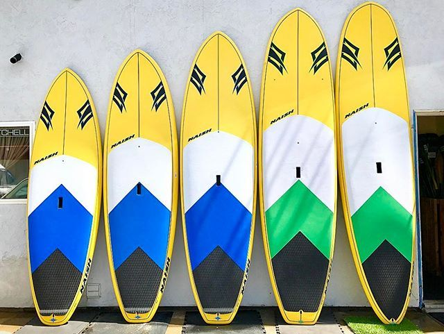 """Sale Alert  Five ✋️ Naish Boards available at wholesale prices. Only one available in each size, so be sure to contact us right away to claim the one you want. Pictured from right to left 8'10, 9'5"""", 10' Mana, 10'10"""" and 11' Nalu.  Call us at 760-602-9767 or email PaddlePlanet101@gmail for more information. @naishsup . . #paddleplanet #paddleboard #sale #northcounty #sandiego #california #sup #shopping #shoplocal #shopsmall #shopping #lajolla #delmar #solanabeach #cardiff #encinitas…"""