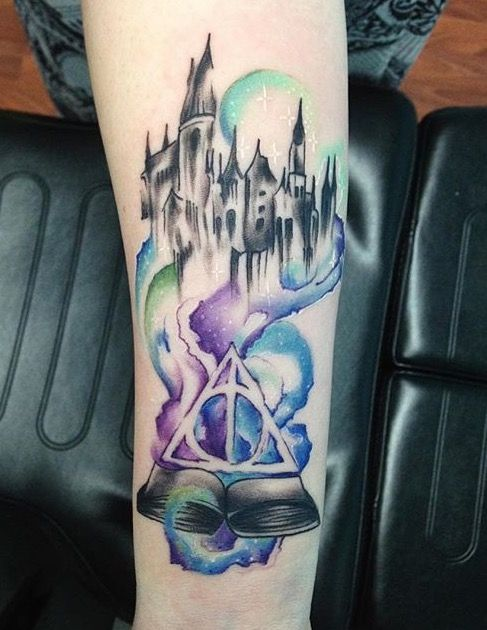 Harry Potter watercolor tattoo. Hogwarts tattoo.