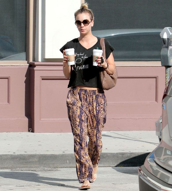 Casual cute! Kaley Cuoco goes for coffee in a printed crop top and baggy ikat pants.