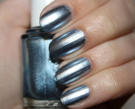 A metallic blue nail polish is the perfect hue for a festive, wintry manicure. #metallic #holiday #nail #design #art