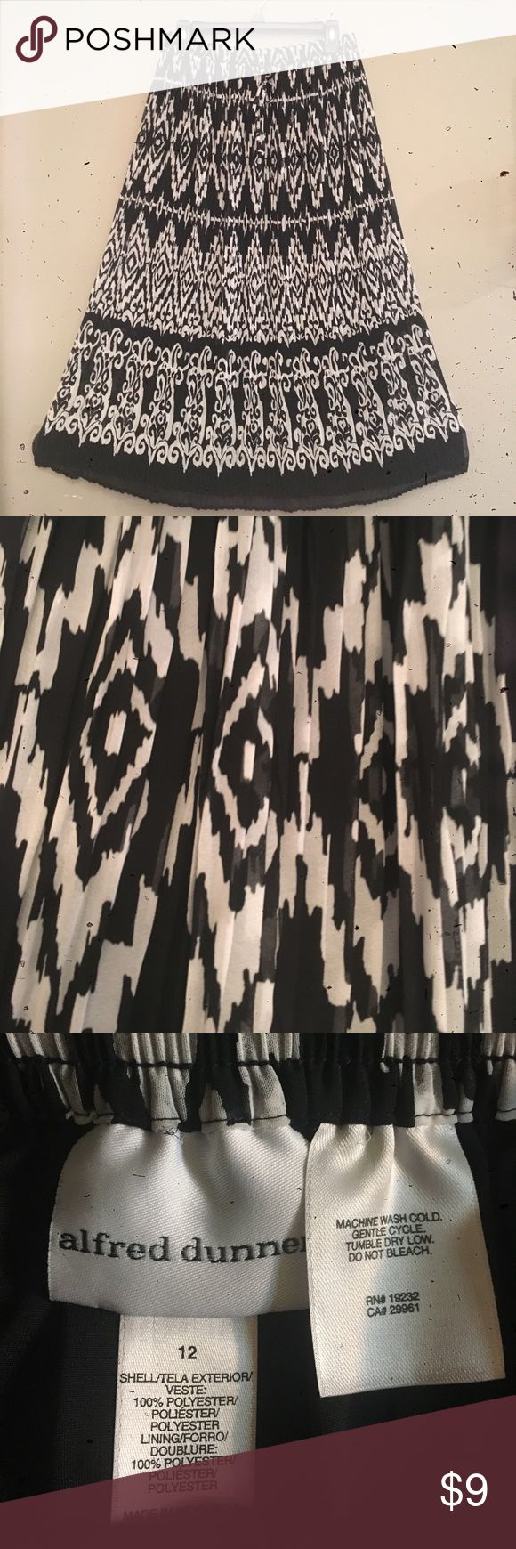 Skirt Nice, comfy, ankle length, polyester skirt. Black and white pattern, southwestern look. Elastic waist with drawstring. Alfred Dunner Skirts Maxi