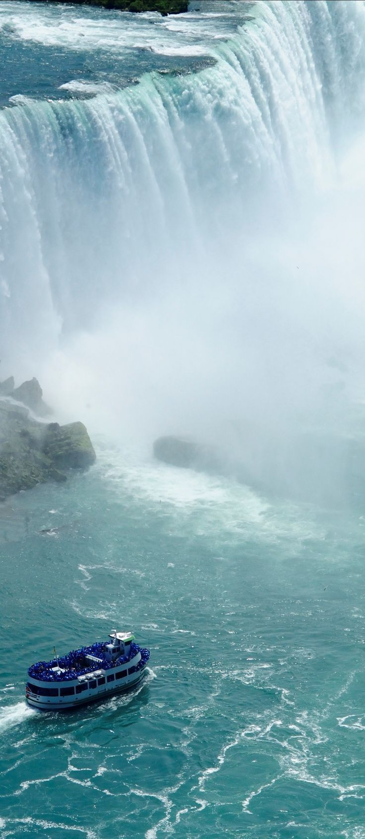 The Maid of the Mist boat ride - fun but got totally soaked being so close to the falls - Niagara Falls, Canada, take a boat ride so close to the falls, amazing