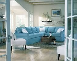 Soft Blue Comfortable Sectional Sofa For Elegant Beach Themed Living Room Ideas With Ship Miniature And Wicker Coffee Table Beach Style Living Room. Terrific Beach Themed Living Rooms Ideas