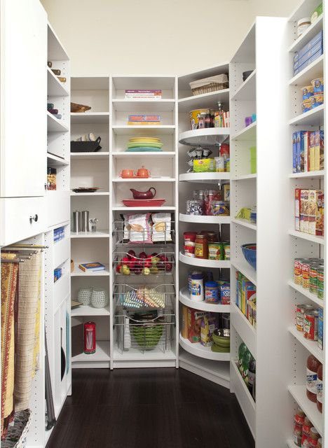 Fabulous pantry. I especially love the tall lazy Susan in the corner.