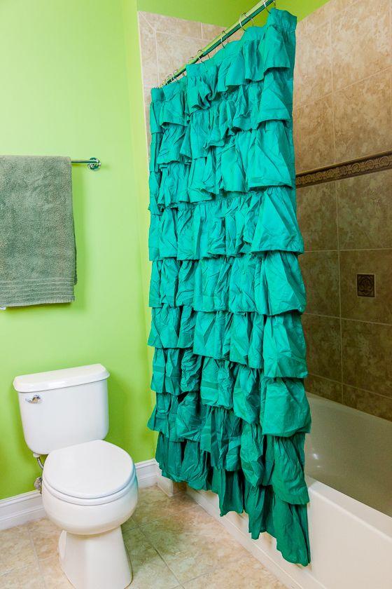This #bathroom Features Lush Decor Ruffle Green Shower Curtain