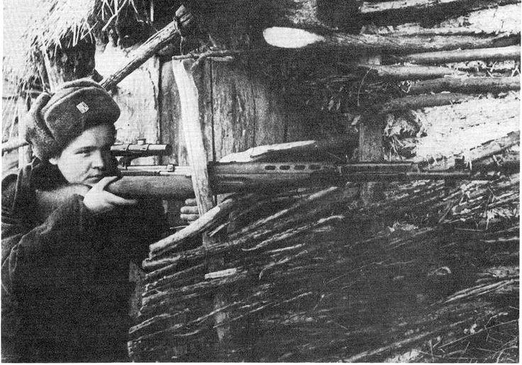 Czech sniper Marie Ljalková posing with SVT-40 sniper rifle, date unknown | World War II Database