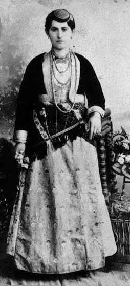 Traditional festive costume of the 'Rum' (Greek-Orthodox) inhabitants from the Pontos region (Black Sea coast and hinterland).  Late-Ottoman era, urban style (Trabzon), early 20th century.  They were expelled from Turkey in 1923, in exchange for Muslim populations from Greece.  At this occasion Turkey lost a lot of cultural and economic potential, and the expelled lost their homeland.