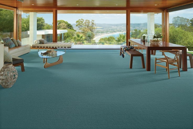 Time for a sea change? Reflect subtle ocean hues with a plush pile carpet in a blue-green shade, accent with mid timber tones and beachside décor of glass, woven cane and coral.  Credits - Carpet: Godfrey Hirst Carpets; Dining chairs: Replica Furniture; Cushions and decor on tables: Hermon & Hermon.