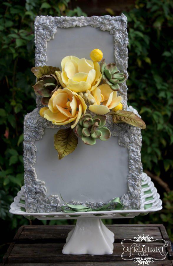Grey cake with yellow magnolia