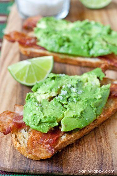 Avocado bacon toasts with lime and sea salt.