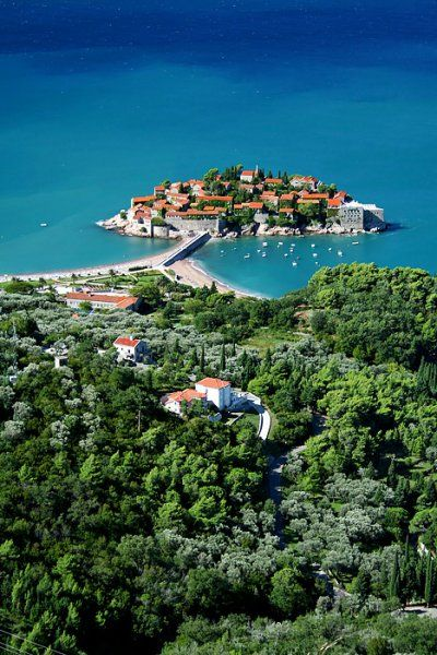 """""""A cluster of pink roofs, 15th-century architecture and honeysuckled alleys form the luxury island of Sveti Stefan."""" Montenegro: the Bradt Guide; www.bradtguides.com"""