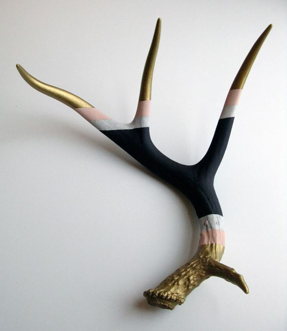 So what if he wants to hang a deer head or antlers... Paint the antlers w/ gold leaf paint & hang.  Instant art!