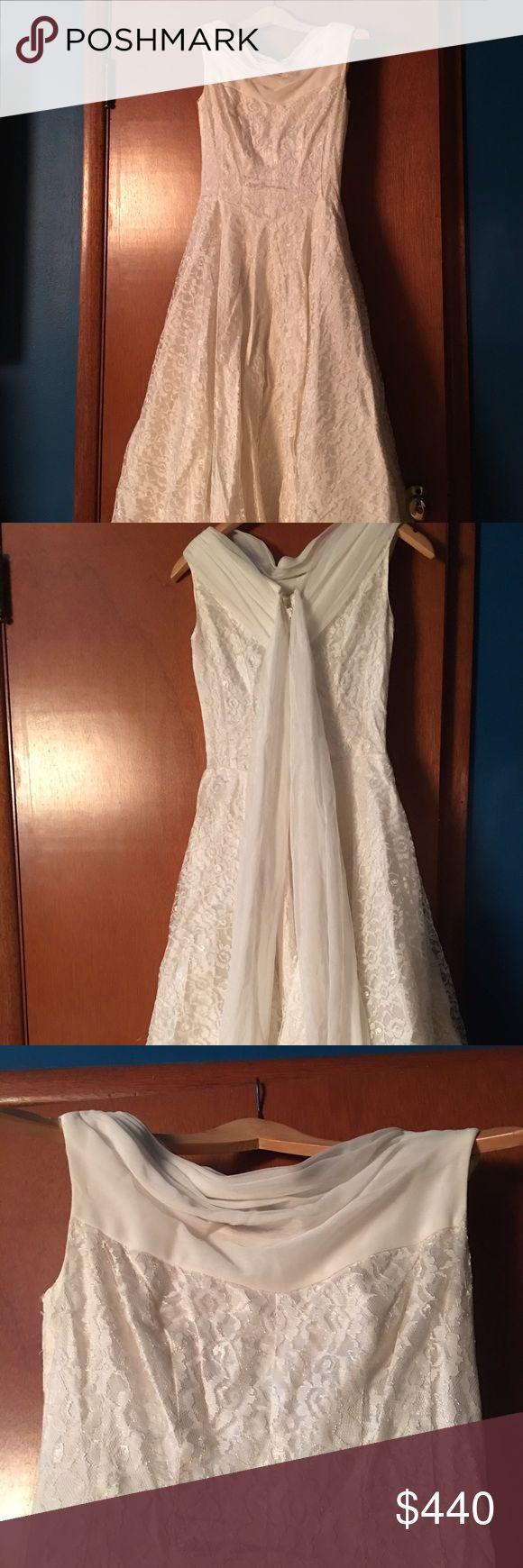 Vntg Tea Length Off White Lace Dress XS/S/petite Vintage Sleeveless Off White Lace Wedding Dress. Metal Zipper. Gorgeous chiffon drape in the back. Slight chiffon drape neck.  13 in across bust. 12 in across waist. 43 in shoulder to bottom of hem. Dresses Wedding