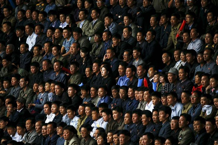 North Korean fans watch their team's preliminary 2018 World Cup and 2019 AFC Asian Cup qualifying soccer match against Philippines at the Kim Il Sung Stadium in Pyongyang on Oct. 8.  Damir Sagolj / Reuters