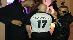 Tim Duncan and Tony Parker pose with a fellow party-goer dressed as Joey Crawford at Halloween.