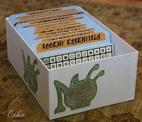 Cricut booklet and overlay storage made using inexpensive photo boxes that you can get at the craft store.