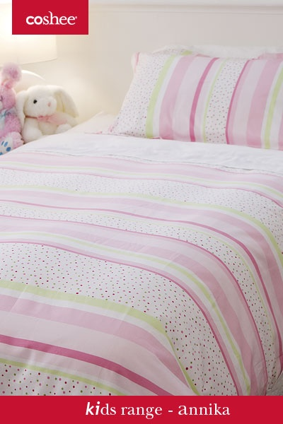 Annika is all about soft and cute but with a pinch of bright red and green dots to add to the collection of lime green and pink stipes. No more difficult to make beds as this set does it for you! A quilt or duvet cover with a clip on top sheet.