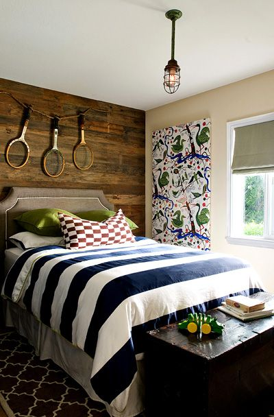 Adorable boy's bedroom design with rustic wood paneled walls, butter yellow walls paint color, ...
