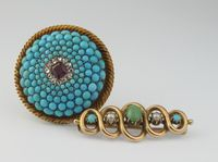 Lot No 700 A Victorian turquoise diamond and ruby target brooch, an opal and pearl bar brooch, sold for £300