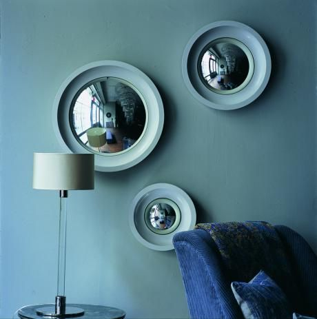 A set of three Convex mirrors, featuring gesso and burnished bole frame with convex glass mirror, also available individually.    OCHRE accessories design