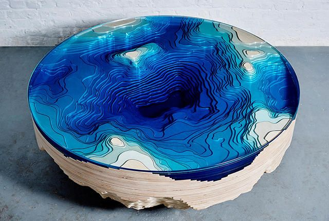 Table designed to look like a topographical map of the seafloor