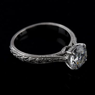 This one is nice and simple, I like the engravings instead of jewels on the band I like just 1 stone -whitney Vintage Style Engraved Solitaire 14K White Gold Engagement Ring