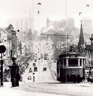 A Tram travels up William Street towards Kings Cross. Date 1930