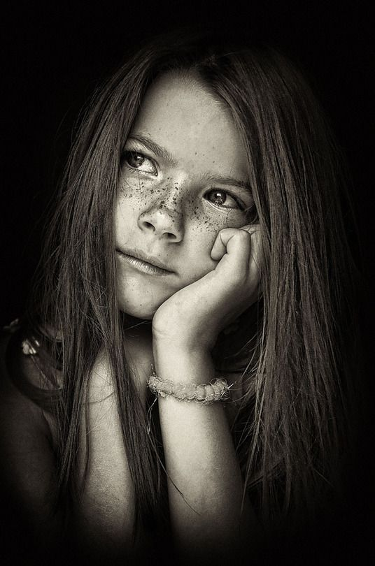 I LOVE how her freckles just POP out in this picture!  Black and white is classic and lets your eye see the little details in a picture.