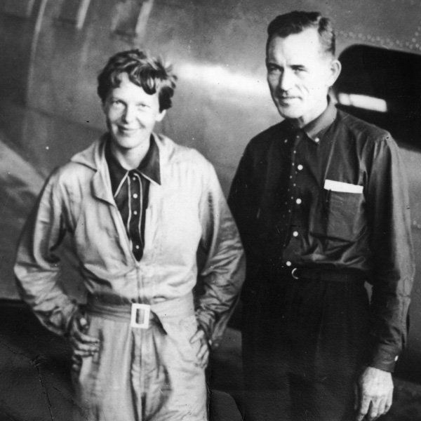 American aviatrix Amelia Earhart (1897 - 1937) with her navigator, Captain Fred Noonan, in the hangar at Parnamerim airfield, Natal, Brazil, June11, 1937. Together they are attempting a circumnavigation of the globe. (Agency reference - 3308131)