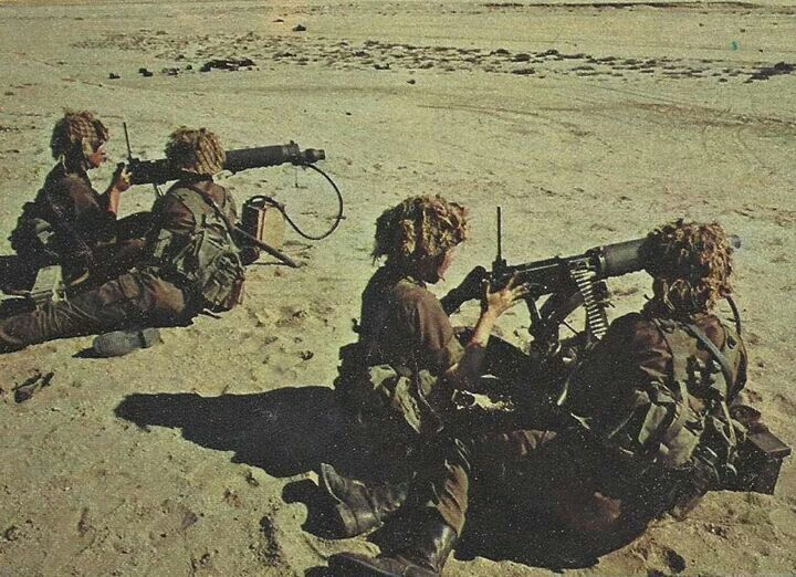SADF Vickers HMG crews in action. South Africa re-tooled their WWII era Vickers Guns to fire 7.62x51 and retained them in service through the 1980s. These are in use in 1977 during the Border War.