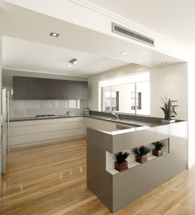 I like the colour combo of bench tops and cupboards: Source DJ's Kitchens