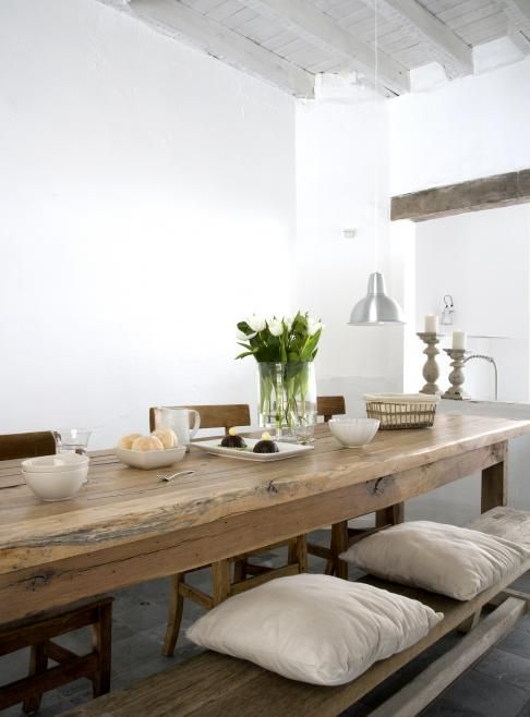 bright walls allow this wooden dining tables beauty to take center stage - Long Kitchen Tables
