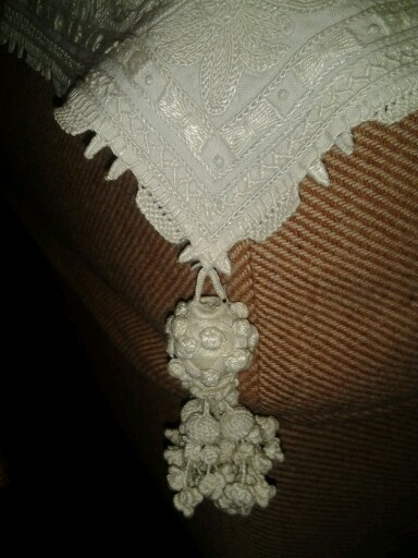 Antique tassel on tablecloth
