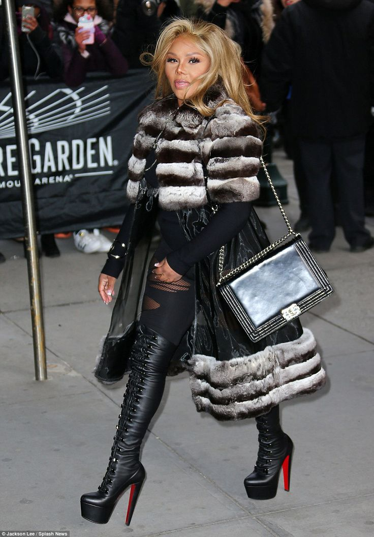 Hip hop style: Lil' Kim is famous for her wild fashion ways and she certainly carried on that trend as she strolled to Kanye West's Yeezy 3 show during New York Fashion Week on Thursday while clad in a fur-trimmed coat, clingy bodysuit and thigh-high platform boots
