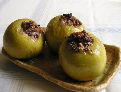 Campfire-baked apples, filled with dried fruit and nuts plus a pinch of sugar and cinnamon.