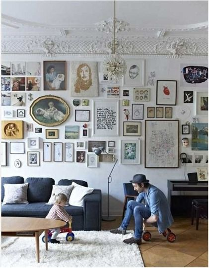 I love this mix of drawings. Lots to look at, and I'd want a quiet space somewhere in the house, but the living room seems perfect for all that creative energy on the wall