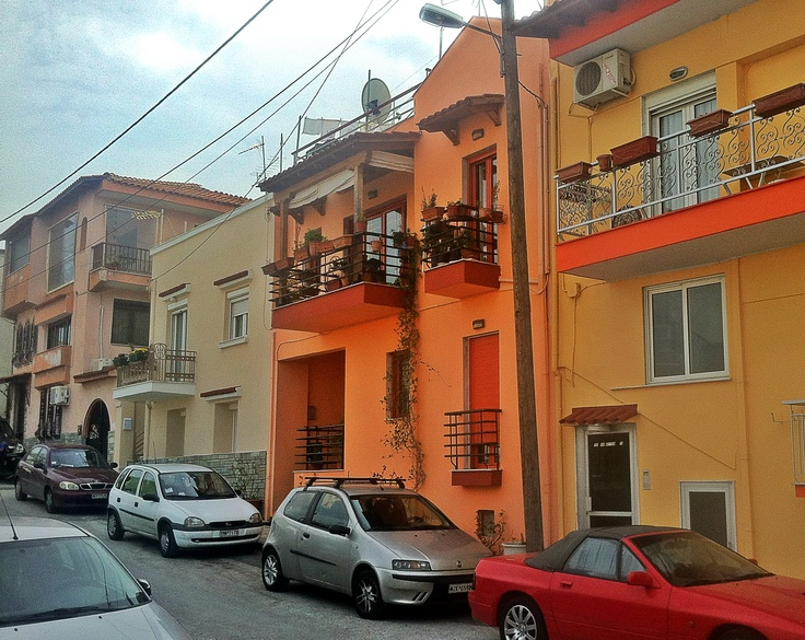 An array of colorful houses across the Agios Vasileios church in Sykies. (Walking Thessaloniki, Route 11- Upper Town c)