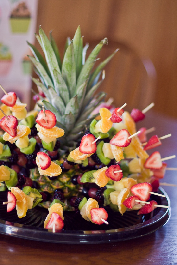 A Pineapple Fruit Skewer thing I make for parties.  Really simple, just follow the colors of the rainbow and put them on a stick (ROY G BIV = Red Strawberry, Orange slices, Yellow Pineapple Chunks, Green Skinned Kiwi Chunks, Blue-ish Blackberries, Indigo sort of Grapes, Violet almost black grapes)