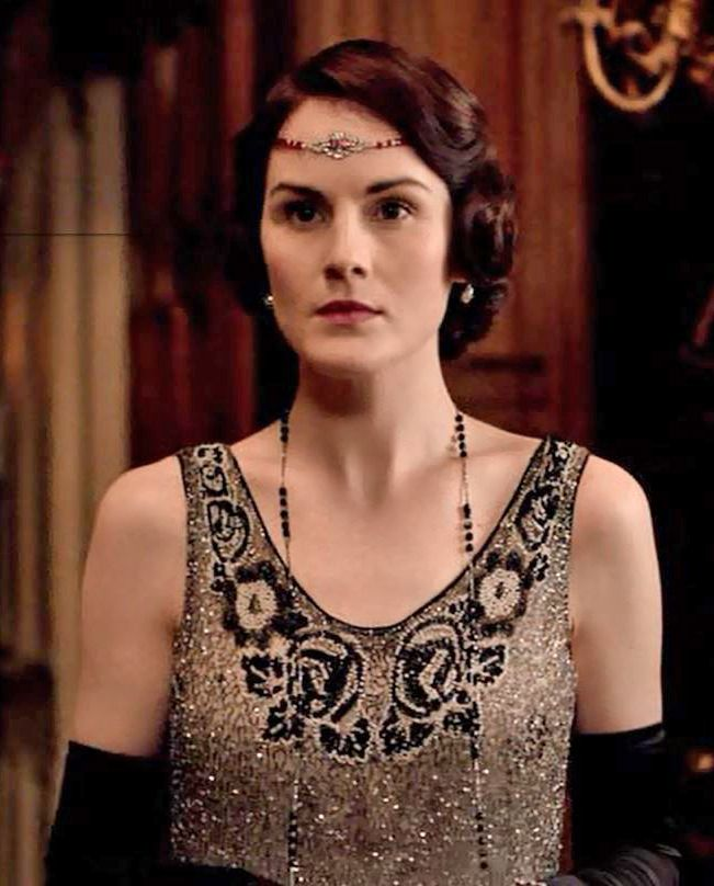 Mary looks stunning in a silver beaded flapper dress at the Downton Cocktail party hosted by  Lieutenant Lord Grantham season V