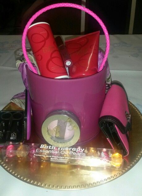 Manicure set, cellophane bag, Avon shimmer powder, hand cream and lip gloss . Scarf and eye make up