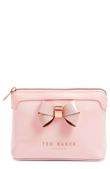 A totally cute pink make up bag to store all of the essentials. Not to mention the adorning pink bow is such a cute detail. Might have to pick up two from the NSale.
