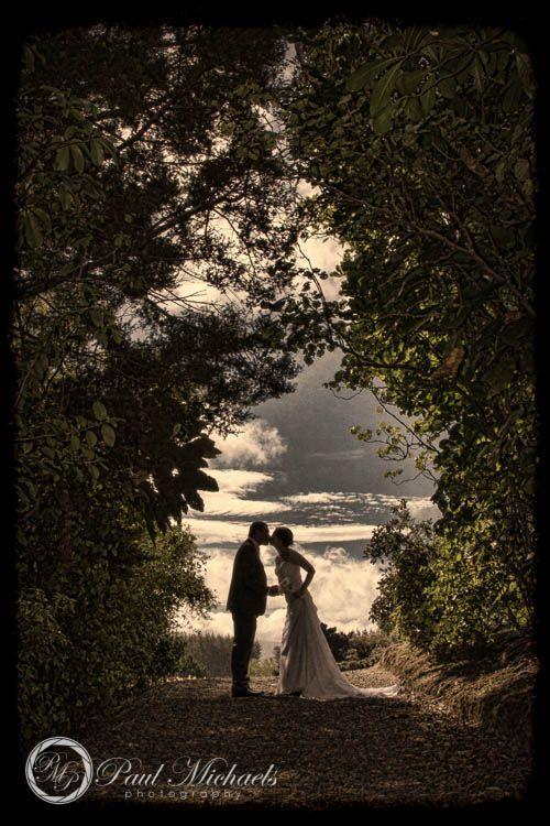 Kiss through the trees at Southwards venue. PaulMichaels Wellington wedding photography http://www.paulmichaels.co.nz/weddings/