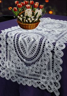 "Our lace runner with its genteel Victorian air offers the look of a treasured family heirloom to adorn your dinner table or buffet. Handcrafted with battenberg lace. 100% cotton. Imported. Color: White.  Size: 16x54"". Available also in 16x36"", and 16x45"". **Due to handcrafting, variations in sizes will occur.**"